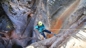 a person canyoneering in Zion
