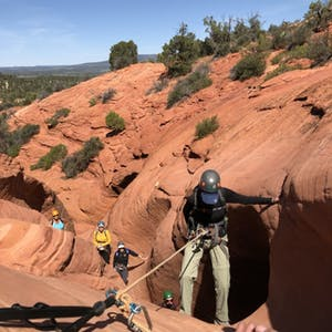 a group of people in a canyon
