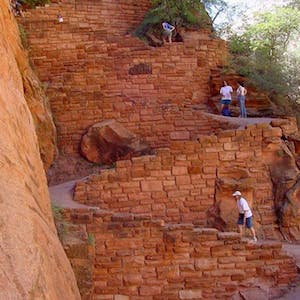 hikers on walter's wiggles section of zion national park's angels landing trail