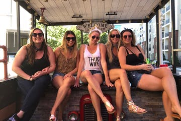 a group of girls on the tractor