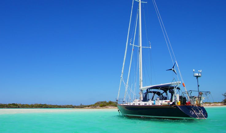 Sailboat anchored off island in the Caribbean