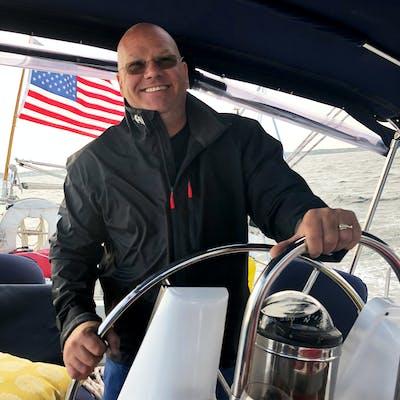 Captain Craig at the wheel of the sailboat