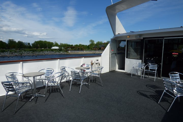 Grand Lady deck with tables set for our casual cruise