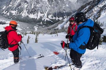 group of skiers looking down slope