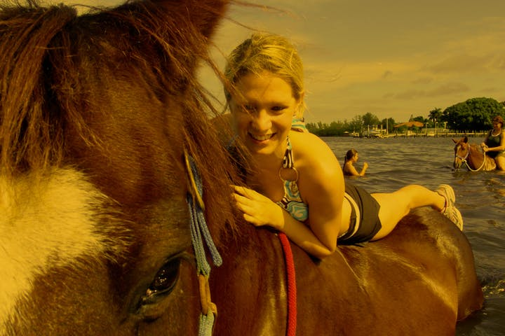 Woman laying on horse