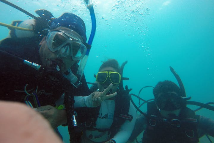 Three scuba divers taking a selfie