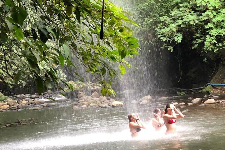 Girls bathing in a river