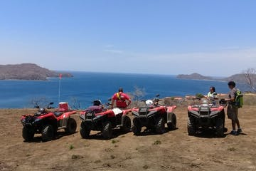 four wheelers overlooking ocean