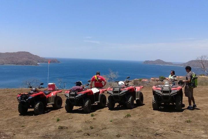 four wheelers overlooking ocean