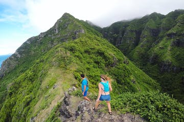 Hikers on top of mountain ridge in Hawaii