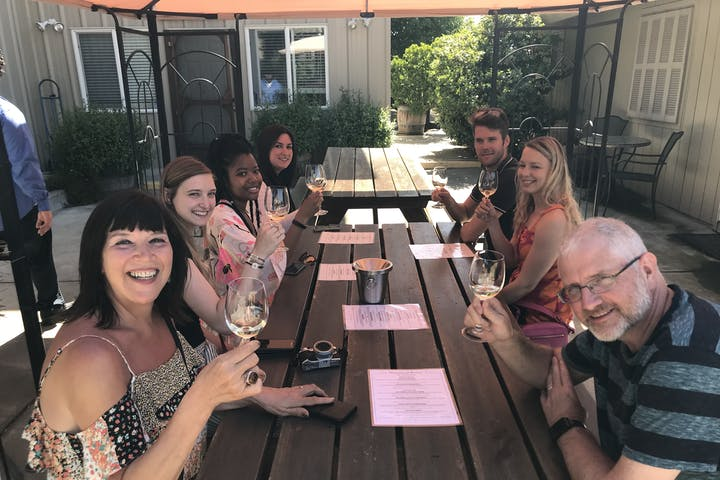 happy tour group at wine tasting