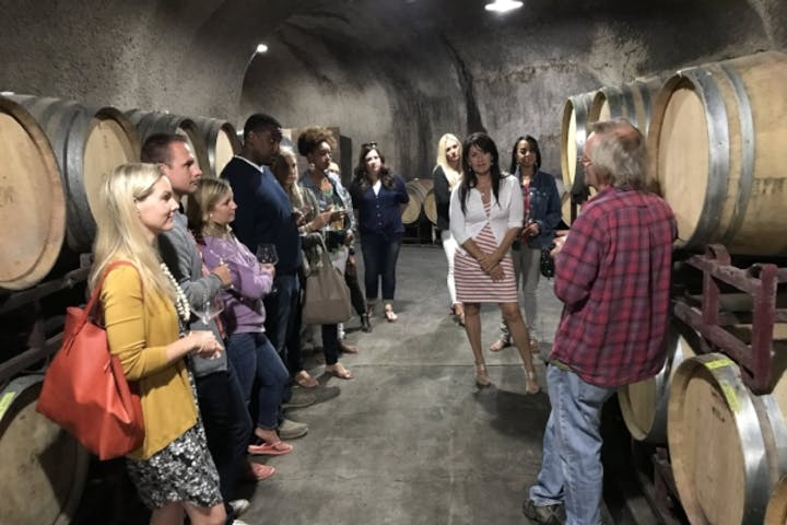 group in wine cellar