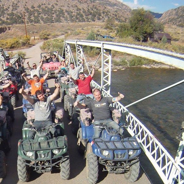 bug atv tour group giving the thumbs up on a bridge