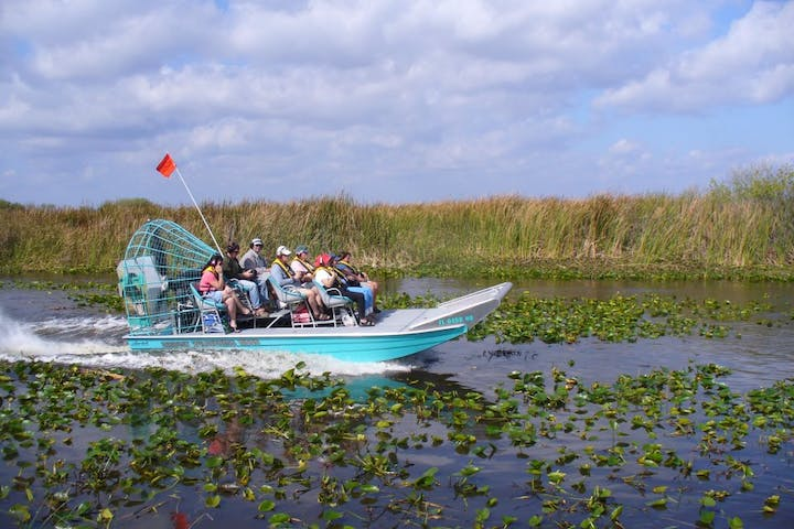 Group of people in an airboat