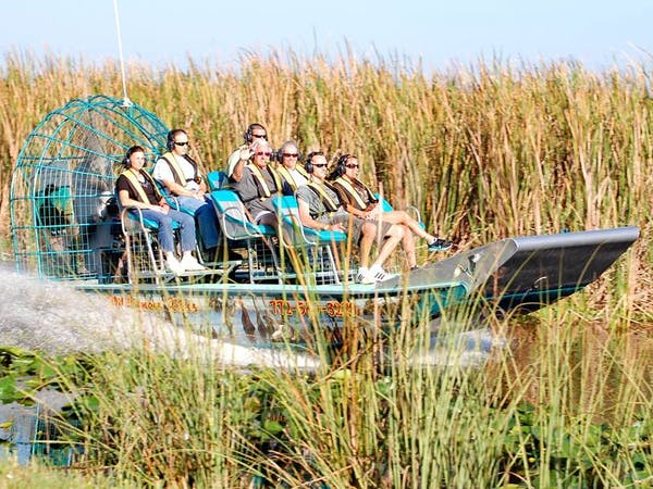 Airboat tour sailing through marsh