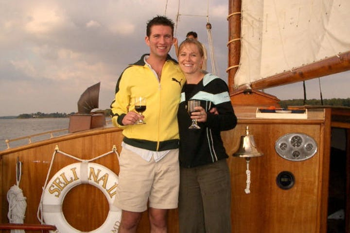 two people toasting on the sailboat