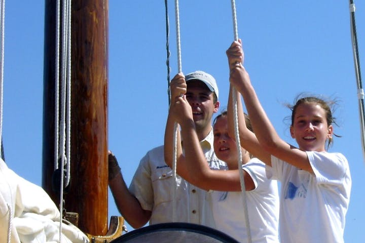 tugging on ropes on the sailboat