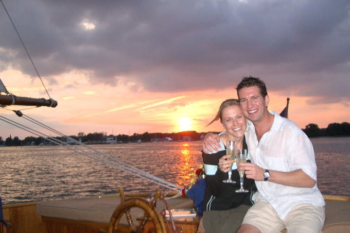 couple toasting at sunset with champagne