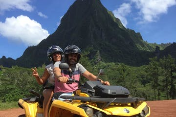 A couple on an ATV.