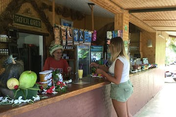 A woman ordering a drink from a bar.