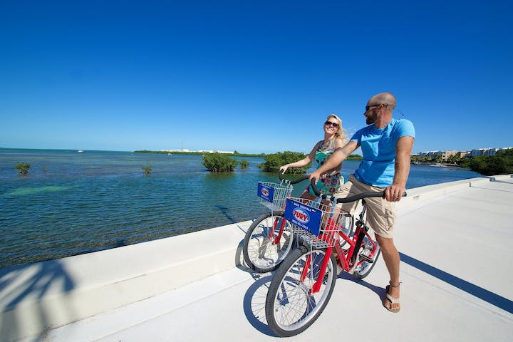 couple biking through key west