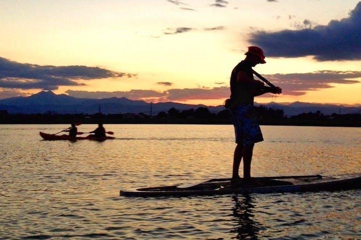 A paddleboarder with a ukulele