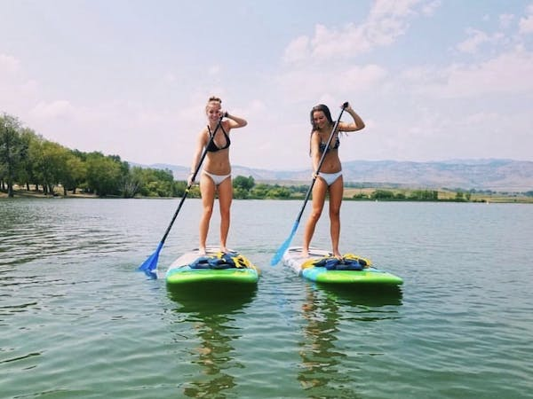 two girls on paddle boards