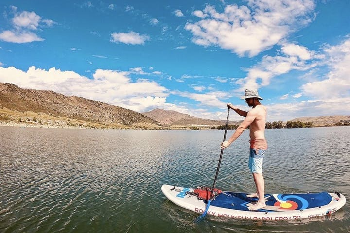 man paddle boarding side view