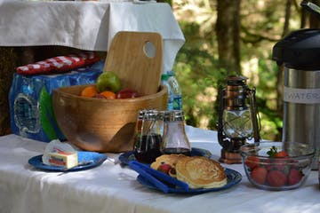 Plate of pancakes and fruit in the rainforest