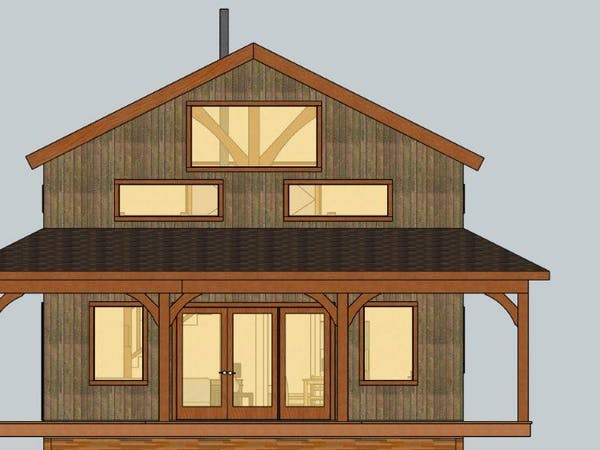 Front façade of Nowhere cabin. The cabin has a huge porch on the lower floor. The lower floor has two huge windows and a huge door that is also windows. The upper floor has three large windows and you can see the cabin beam structure inside.