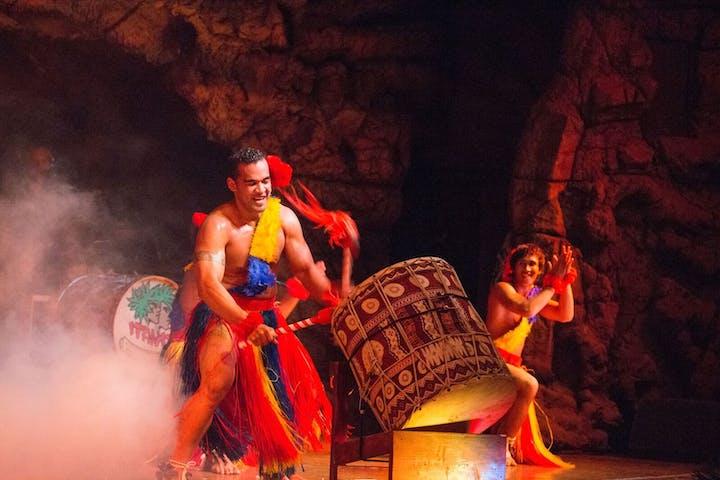 A man banging on Tonga drums