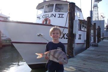 kid and his fish
