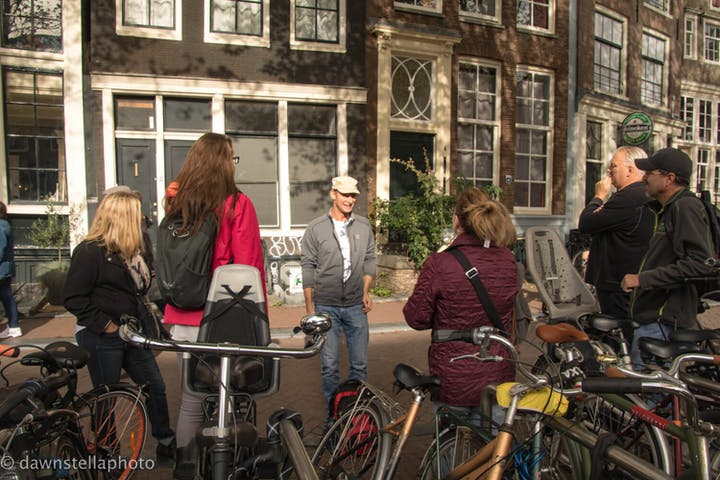 Amsterdam walking tour guide talking to a group. a Tour Group