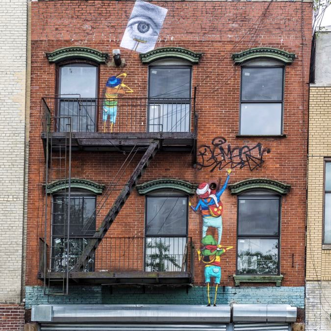 Os Gemeos x JR Collaboration on the Lower East Side