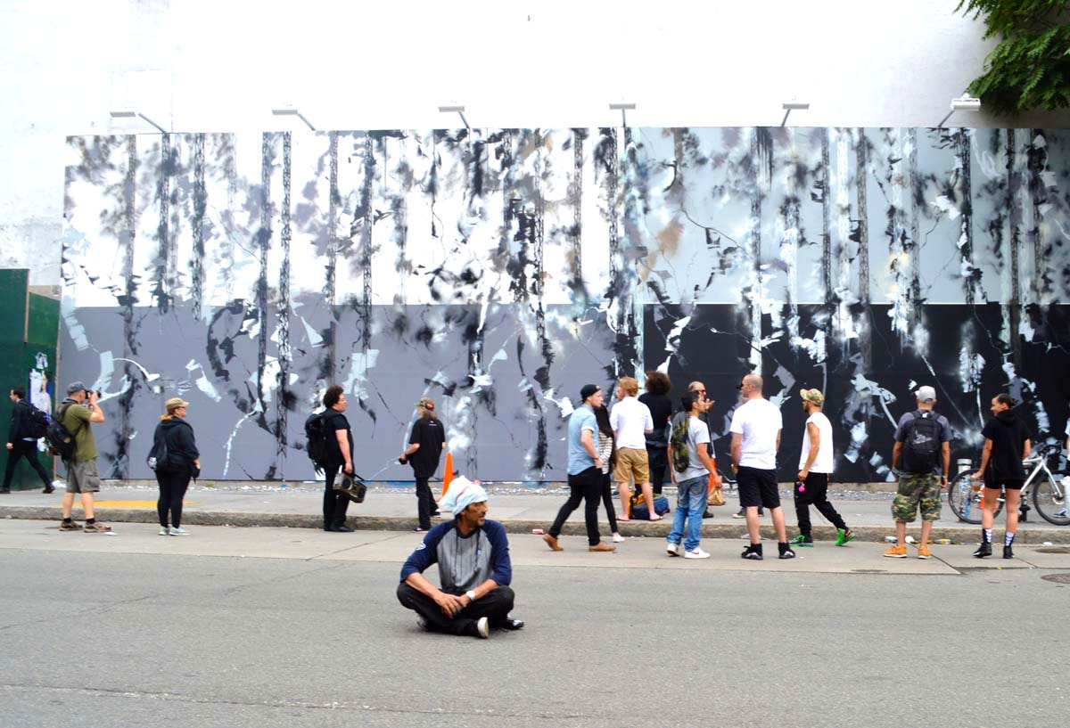 Futura sits in front of the newly finished Bowery Wall