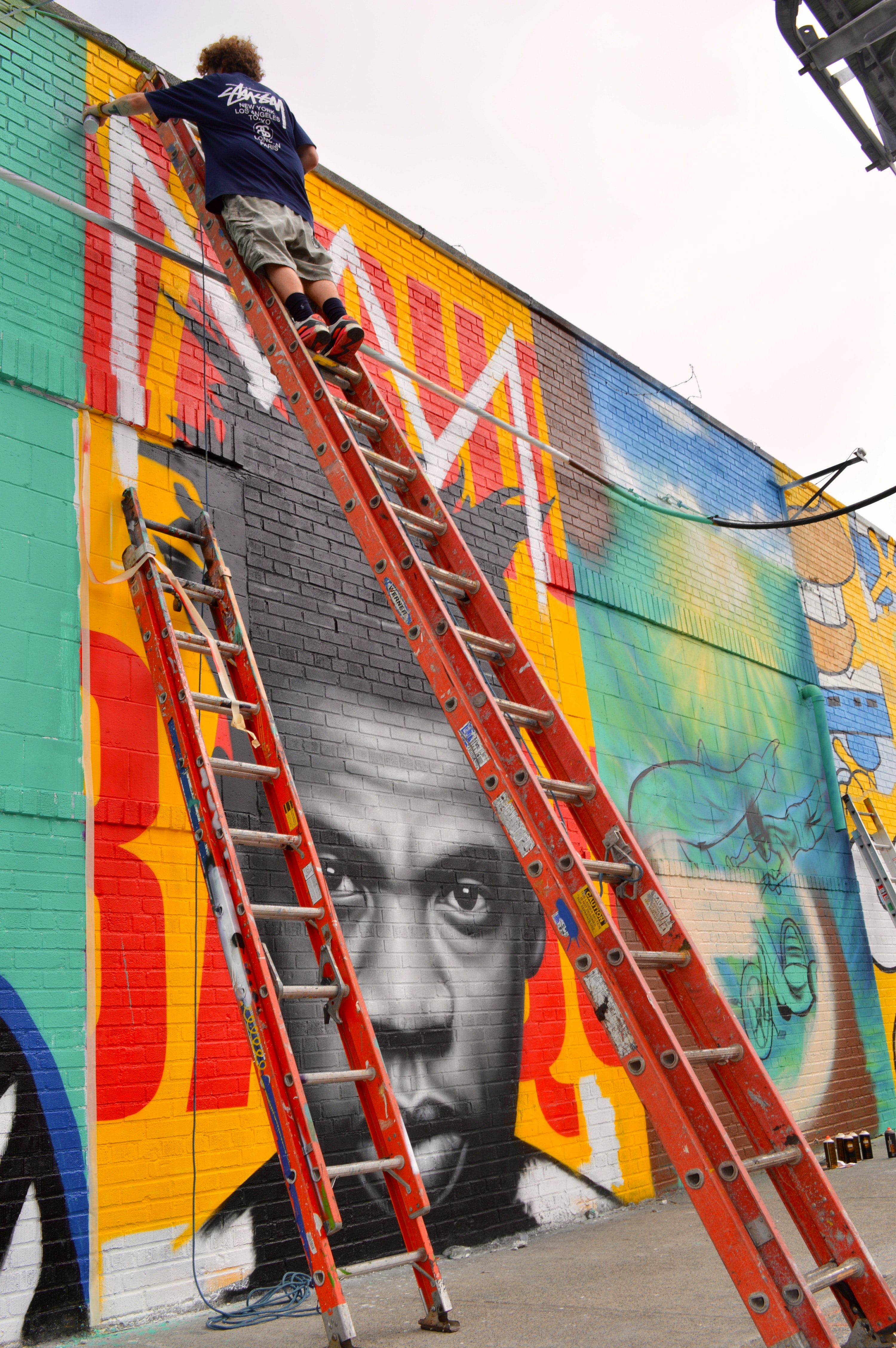 Owen Dippie at Work for the Bushwick Collective for his Jay-z/Basquiat Piece 1