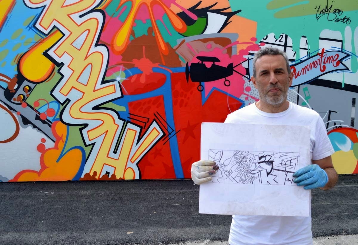 "John ""Crash"" Matos with his sketch in front of his new Wall"