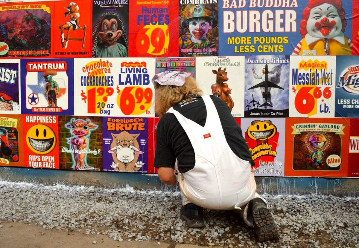 Ron English pastes Up at the Bowery Wall