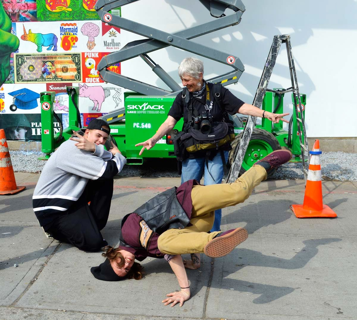 Martha Cooper enjoys a little break dancing in front of the new wall