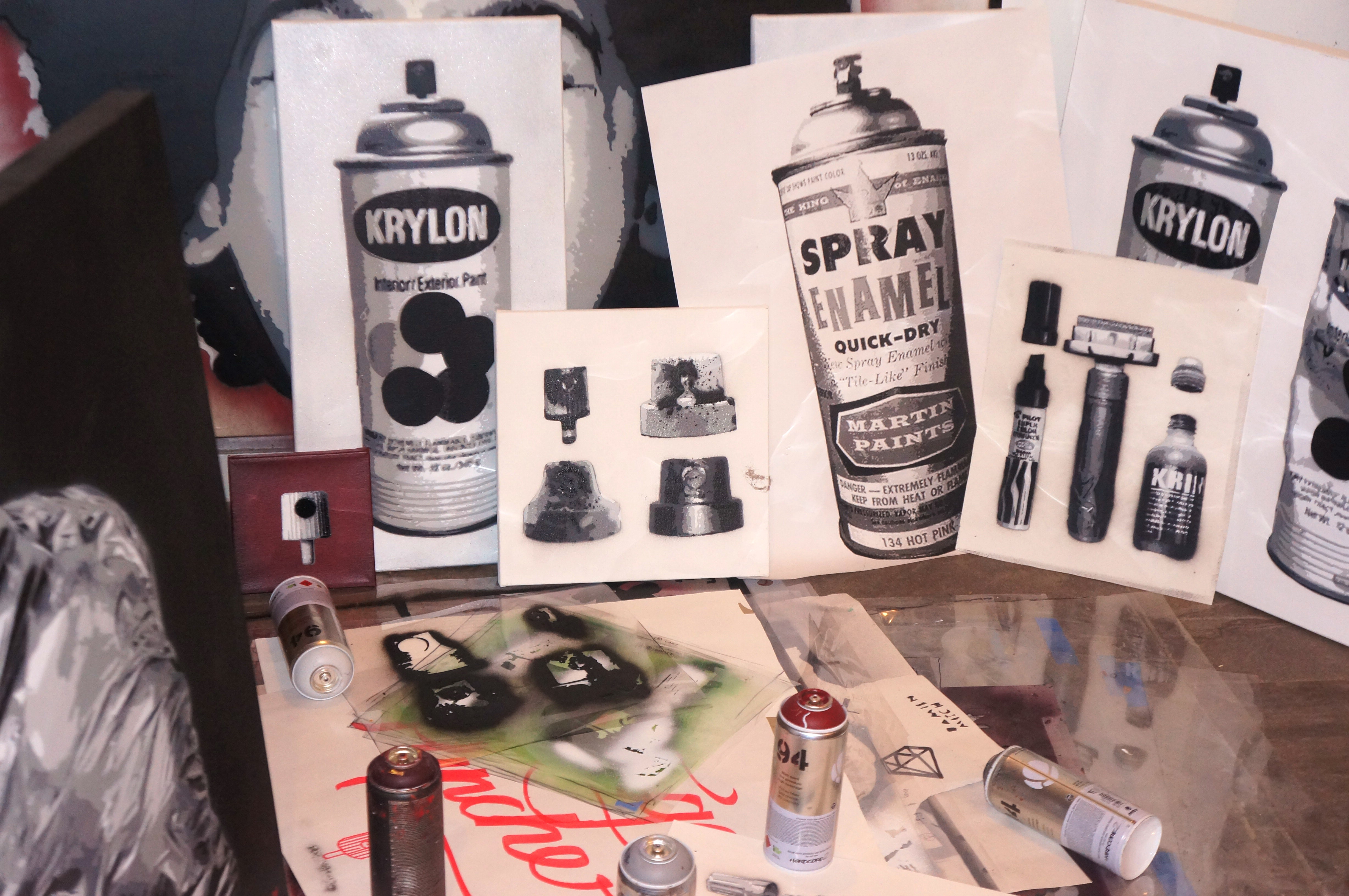 Krylon cans, stencils, and cans in Damien Mitchell's studio