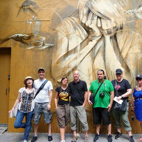 Graff Tours Group in front a the mural by FAITH47