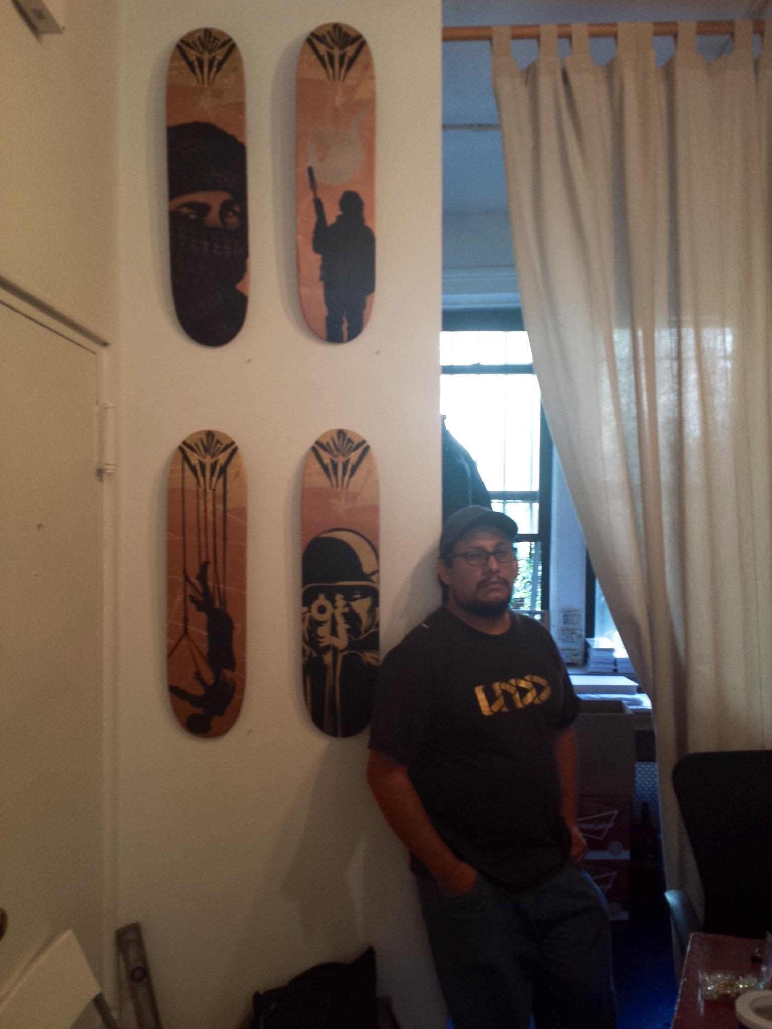 Undo in front of his Designer Skate Boards