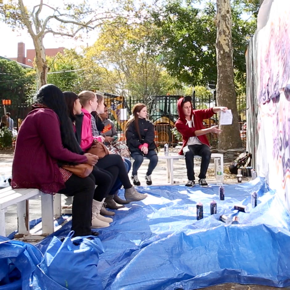 Damien Mitchell explaining how to go from a sketch to a Piece to St. John's University students – Work on Canvas 2014