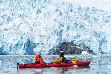 Couple Kayaking Aialik Glacier