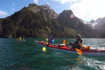 Kayakers paddling near Seward Alaska