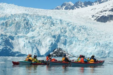 Kayakers near Aialik Glacier in Alaska