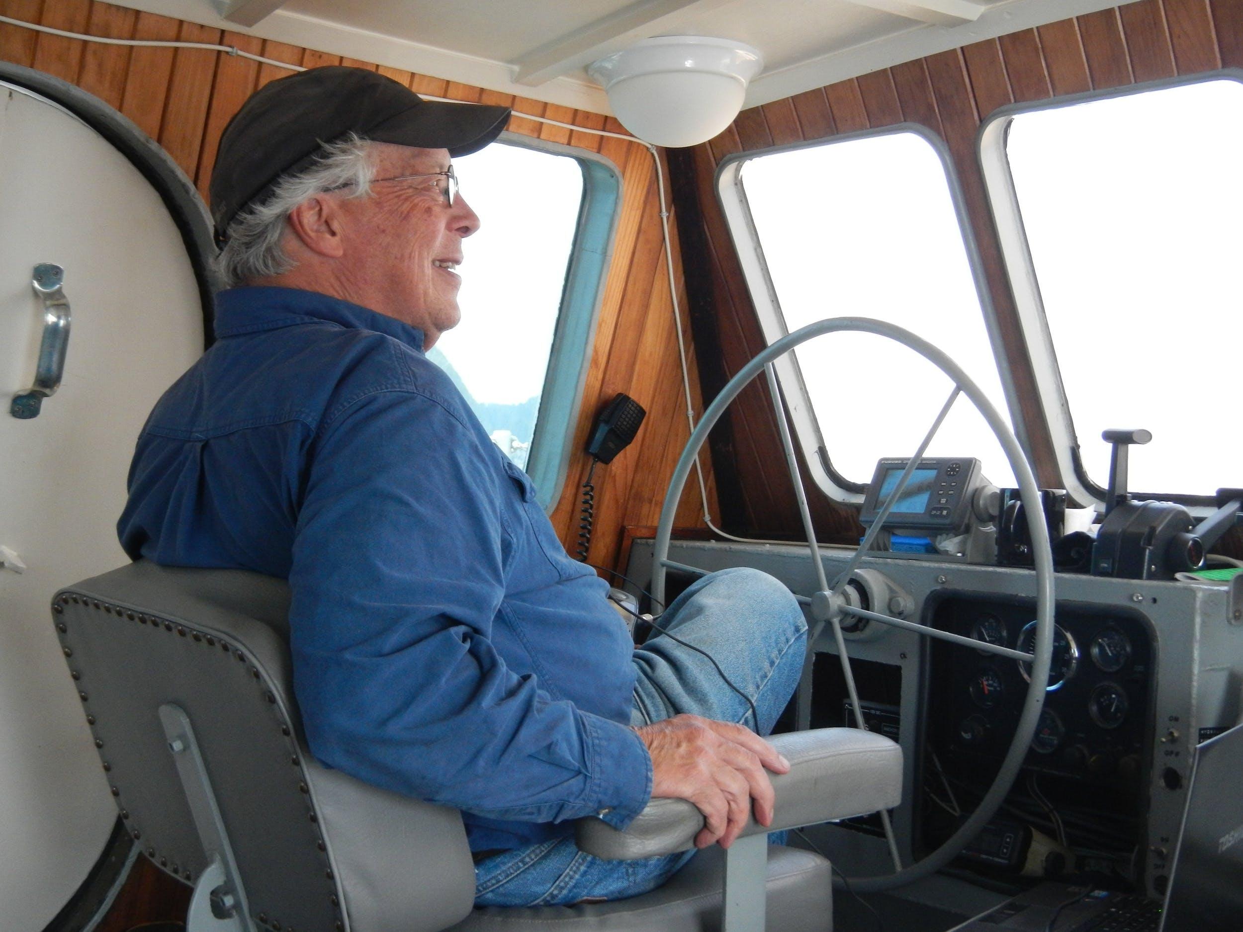 Captain Mike Brittain on the bridge of his ship near Seward, AK