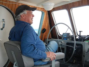 Captain Mike Brittain on the bridge of his ship near Seward, AK