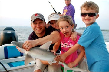 Man and children with Shark