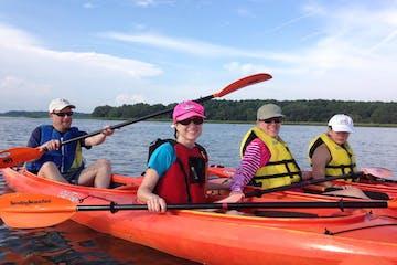 Kayakers smiling at camera